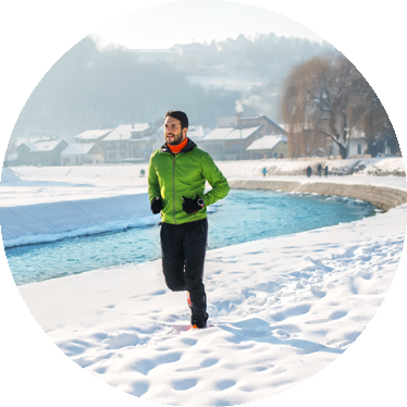 man jogging outside in the snow