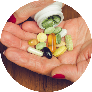 womans hand holding supplements